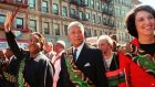 David Dinkins marching at the front of the 29th annual African-American Day Parade in Harlem, flanked by Al Sharpton and Ruth Messinger, in 1997. Photograph: Michael Schmelling/AP