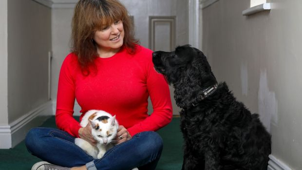 12/11/20: Actress Tara Flynn with her cocker spaniel Jack and cat Buffy.Photograph by Crispin Rodwell for the Irish Times