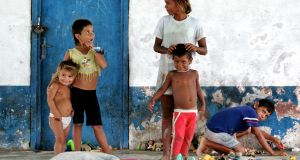 Research  showed that Ireland's extremely generous tax breaks afforded to companies onshoring intellectual property is starting to impact on African and Latin American countries. Photo: Children playing in remote village of El Yaque, Margaritta Island, Venezuela.