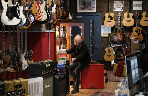 TUNING UP: Owen McQuail of Some Neck Guitars, Dean Street, The Liberties, Dublin, preparing hopefully to reopen the store on December 1st. Photograph: Nick Bradshaw
