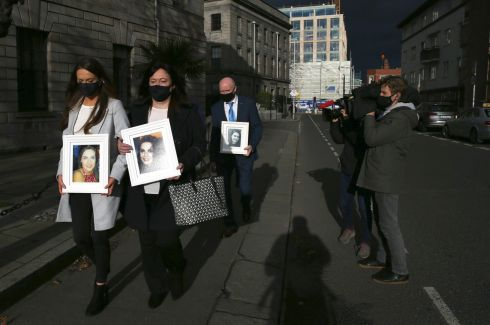 LISA NILAND SETTLEMENT: Amy, Angela and Gerry Niland, from Sligo, leave the High Court in Dublin with photographs of the late Lisa Niland, who died in 2017 of a bleed to the brain three days after collapsing and being rushed to Sligo General Hospital. The hospital and HSE have reached a confidential settlement with the family, who also received an apology over Lisa's treatment. Photograph: Collins Courts