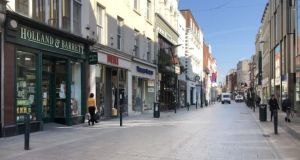 An almost empty Grafton Street in Dublin during the Covid-19 restrictions. Photograph: Bryan O'Brien