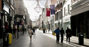 Grafton Street in Dublin on Tuesday, with Christmas lights overhead. Photograph: Gareth Chaney/Collins
