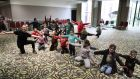 Syrian children enjoying a workout class at a centre after arriving in Ireland. The group of 190 Syrians will stay in two centres for four to five months before moving into rental accommodation around the country. Photograph:  Nick Bradshaw