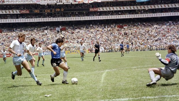 Diego Maradona scores against England during the 1986 World Cup in Mexico. Photograph: AFP via Getty Images