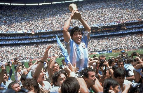Diego Maradona holds up his team's trophy after Argentina's 3-2 victory over West Germany at the 1986 World Cup final. Maradona died from a heart attack on Wednesday. Photo: AP Photo/Carlo Fumagalli, File