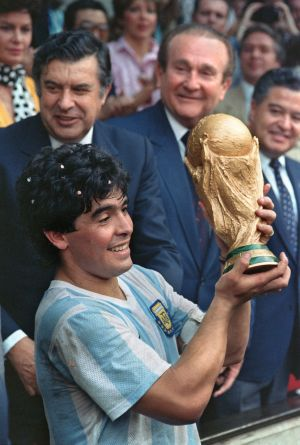 Diego Armando Maradona displays the World Cup trophy after a 3-2 victory over West Germany in 1986. Photo: AFP via Getty Images