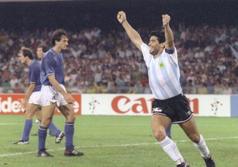 Diego Maradona celebrates Claudio Caniggia's goal against Italy the 1990 World Cup. Photo: DANIEL GARCIA/AFP via Getty Images