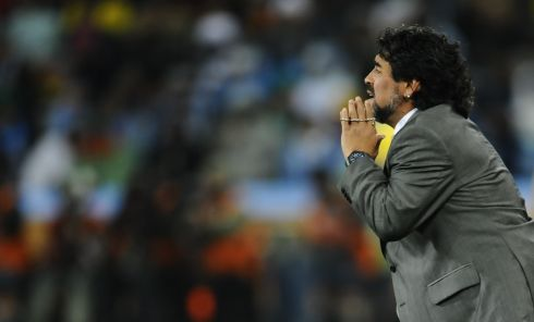 Diego Maradona gestures during the 2010 World Cup round of 16 match between Argentina and Mexico. Photo: DANIEL GARCIA/AFP via Getty Images)