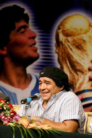 Diego Maradona smiles at press conference in in 2003.  Photo: EPA/DIEGO AZUBEL