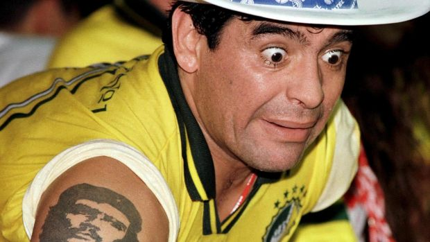 Diego Maradona watching a Carnival parade at the Sambadrome in Rio de Janeiro in 1998. Photo: Gregg Newton/Reuters