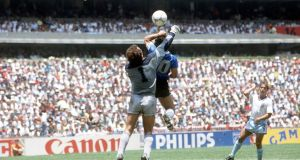 Argentina's Diego Maradona scores his 'Hand of God' goal past English goalkeeper Peter Shilton at the 1986 World Cup. Photo:  Bob Thomas/Getty Images