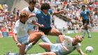 Diego Maradona  dribbles past three English defenders during the World Cup quarter-final against England at the 1986 World Cup in Mexico. Photograph: AFP via Getty Images