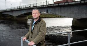 Dr Paul Armstrong at the Lifford Bridge beside his practice in Lifford, Co Donegal. Photograph: Joe Dunne