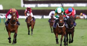 Champ (green and gold) ridden by Barry Geraghty wins the RSA Insurance Novices' Chase  from Minella Indo at Cheltenham back in March. Photograph: Michael Steele/Getty Images