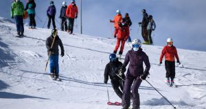 Skiers, some wearing  face masks, take to the slopes in the ski resort of Verbier in the Swiss Alps on November 15th. Photograph:  Fabrice Coffrini/AFP via Getty