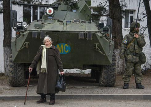 Margarita Khanaghyan (81) walks past Russian peacekeepers in the town of Lachin after six weeks of fighting between Armenia and Azerbaijan. Photograph: Karen Minasyan/Getty