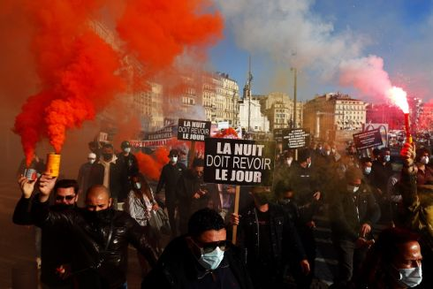 Protesters participate in a demonstration of restaurant and bar owners along with demonstrators from various economic sectors against the closing of non-essential businesses in Marseille, France. Photograph: Guillaume Horcajuelo/EPA