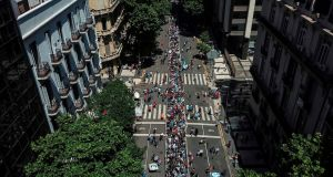 An aerial view of people queueing along Avenida de Mayo in Buenos Aires to reach the Casa Rosada presidential palace to pay tribute to Diego Maradona. Photograph:  Ivan Pisarenko/AFP via Getty Images