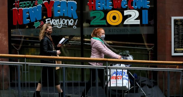 People walk past The Kitchen Bar at Victoria Square shopping centre in Belfast. Photograph: Brian Lawless/PA Wire