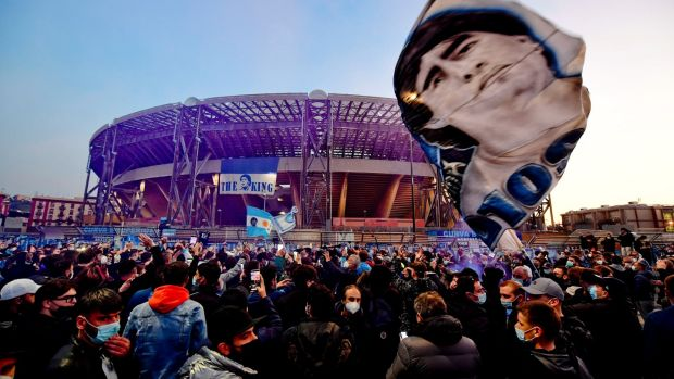 Napoli fans gather outside the San Paolo stadium to pay tribute to Diego Armando Maradona. Photograph: EPA