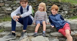 Liam  (10), Johnny  (4)  and Patrick Howard (7).  Their father Brendan is worried they will not be able to attend the same school due to the end of sibling-first admission policies at their local school.