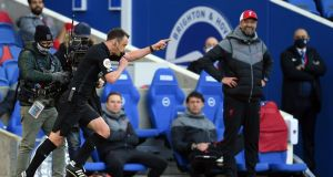 Liverpool manager Jurgen Klopp looks on as referee Stuart Attwell awards a penalty to Brighton. Photograph: Getty Images