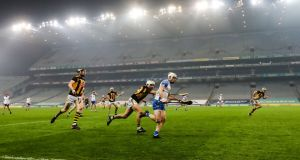 Kilkenny's Padraig Walsh chases Dessie Hutchinson of Waterford (both centre) down the sideline of Croke Park during the All-Ireland senior championship semi-Final on Saturday night. Photograph: Bryan Keane/Inpho