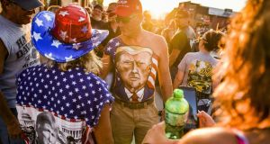 John Riley  shows off his chest painted with a portrait of president Donald Trump during the Sturgis Motorcycle Rally in August, 2020 in Sturgis, South Dakota. Photograph: Michael Ciaglo/Getty Images