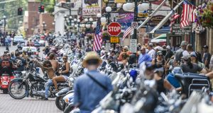 Motorcyclists ride through downtown Deadwood, South Dakota during a rally in August, 2020. Photograph: Michael Ciaglo/Getty Images