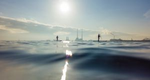 OPEN WATER: Two paddle boarders take advantage of the beautifully still conditions out on Dublin Bay, near the Wooden Bridge in Dollymount. Photograph: Chris Bellew/Fennell Photography