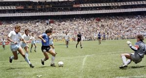 Maradona  runs past England  defender Terry Butcher  before  dribbling past goalkeeper Peter Shilton  and scoring the  goal of the century, during the World Cup quarterfinal  between Argentina and England on June 22nd, 1986 in Mexico City. Photograph:  Getty Images