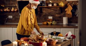 People are being advised to wear a mask when cooking and serving food this Christmas, and the amount of people in the kitchen should be limited. Photograph: Drazen Zigic/iStock