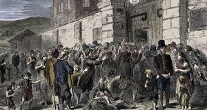The Story of the Irish Famine: starving people at a workhouse gate, in an illustration from The Life and Times of Queen Victoria, by Robert Wilson. Photograph: Print Collector/Getty