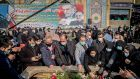 Iranian mourners attend the burial ceremony of slain nuclear scientist Mohsen Fakhrizadeh at Imamzadeh Saleh shrine in northern Tehran on Monday. Photograph: Getty