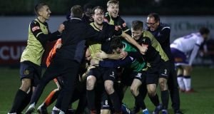 Marine players celebrate after winning their FA Cup second round. Photograph: Getty Images
