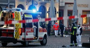 Police and fire officers near where the incident occurred in Trier, Germany. Photograph: Julien Warnand/EPA