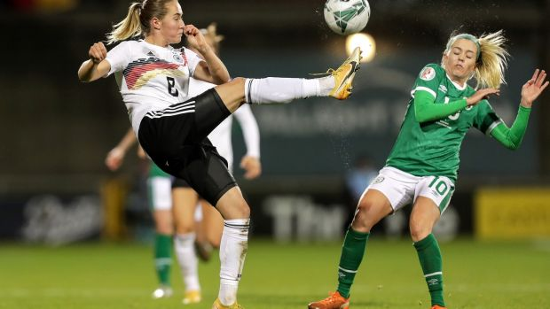 Denise O'Sullivan contests for the ball with Germany's Sydney Lohmann. Photograph: Laszlo Geczo/Inpho