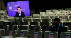 Eurogroup president Paschal Donohoe, on the screen, speaks during an online news conference following a Eurogroup video conference meeting at the European Council headquarters in Brussels, on November 30th. Photograph: Francisco Seco/Pool/AFP