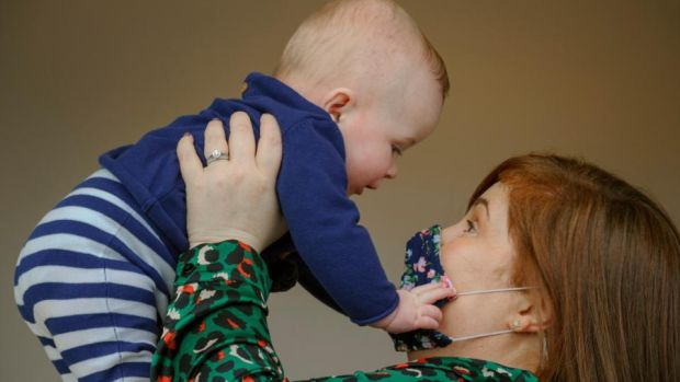 Ciara Clancy holds up her 6-month-old son Iarla in Conna, Co Cork. Photograph: Daragh Mc Sweeney/Provision