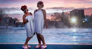 Jessica Walker and Nicola Foster pose at sunrise before swimming at Charlton Lido, Hornfair Park, London, on its first day of reopening after the second national lockdown ended in England. Photograph: Victoria Jones/PA Wire