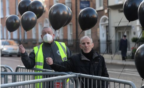 Volunteer Christy O'Brien and Gerry Carney, senior case manager with Inner City Helping Homeless, highlighting the problem of homeless with 56 Balloons representing homeless deaths in a year, outside the Dail. Photograph: The Irish Times