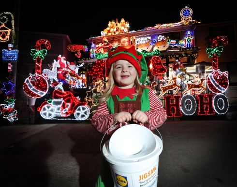 Four-year-old Abi Leonard from Crumlin, Dublin, delivering some Christmas cheer to Crumlin as Josie's Christmas Lights were switched on, marking the beginning of Christmas and raising funds in support for the Jigsaw partnership and the National Centre for Youth Mental Health. Photograph: Robbie Reynolds