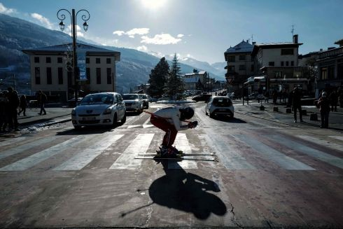 A protester skies on a pedestrian crossing on the sidelines of a demonstration asking for the reopening of the ski resort in the French Alps for the Christmas holidays in Bourg-Saint-Maurice. Photograph: Olivier Chassignole/AFP