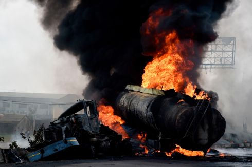 A tanker laden with petrol goes up in flames after it fell over and spilt the contents across the Lagos-Ibadan expressway in Magboro, Ogun state, Nigeria. Photograph: Pius Utomi Expie/Getty
