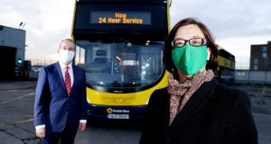 Ray Coyne  of Dublin Bus and Anne Graham of the National Transport Authority at Thursday's announcement of the new 24-hour service for Route 39a. Photograph: Maxwells