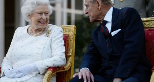 Queen Elizabeth II and the Duke of Edinburgh attending a garden party in Paris in2014.  Photograph: Owen Humphreys/PA Wire