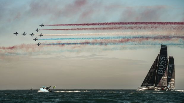 The French airforce's aerobatics Patrouille de France flies over Britain skipper Alex Thomson's boat Hugo Boss at the start of the race. File photograph: Getty