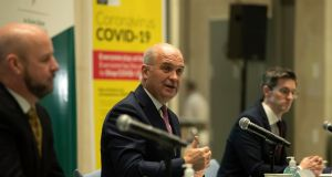 Chief medical officer Dr Tony Holohan with deputy chief medical officer Dr Ronan Glynn (right)  and Prof Philip Nolan (left), chair of the Nphet  modelling group, address the media at the Covid -19 briefing on Thursday evening. Photograph: Colin Keegan/Collins Dublin