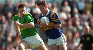 Darragh Ó Sé tracks Tipperary's Derry Foley in 1997. Photograph: Matt Browne/Inpho